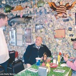 """[Photo: <a href=""""http://www.peninsuladailynews.com/article/20120127/NEWS/301279981/eatery-8217-s-famous-money-walls-to-be-stripped-bare-for-charity#"""">Charlie Bermant / Peninsula Daily News</a>]"""