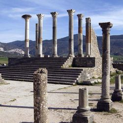 This Thursday, March 8, 2012 photo shows the pillars of the ruined Capitol, once a temple to Jupiter in the ancient Roman city of Volubilis near Meknes, Morocco.