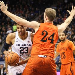 Brigham Young Cougars forward Yoeli Childs (23) tries to dish the ball as Idaho State Bengals forward Blake Truman (24) pressures him as BYU takes on Idaho State at the Marriott Center in Provo on Thursday, Dec. 21, 2017.