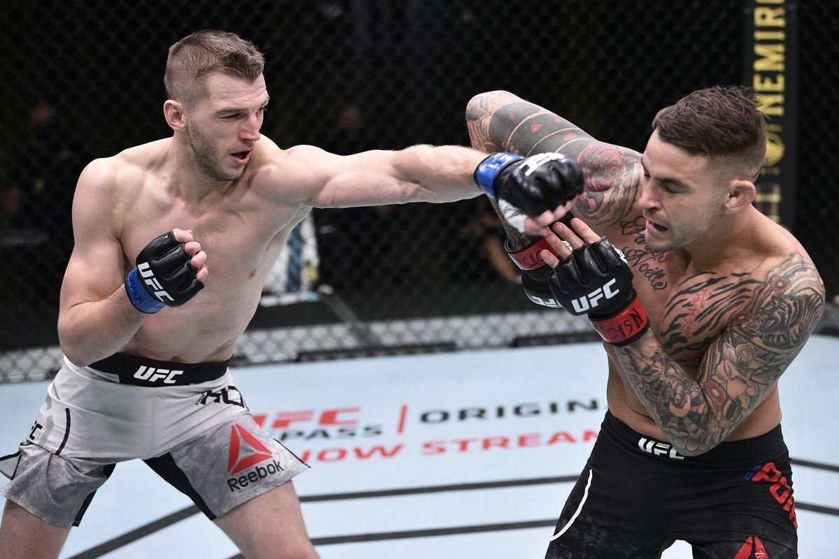 Dan Hooker of New Zealand punches Dustin Poirier in their lightweight fight during the UFC Fight Night event at UFC APEX on June 27, 2020 in Las Vegas, Nevada.