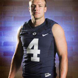 BYU football player Taysom Hill at photo day in the indoor practice facility on campus in Provo, Wednesday, Aug. 12, 2015.