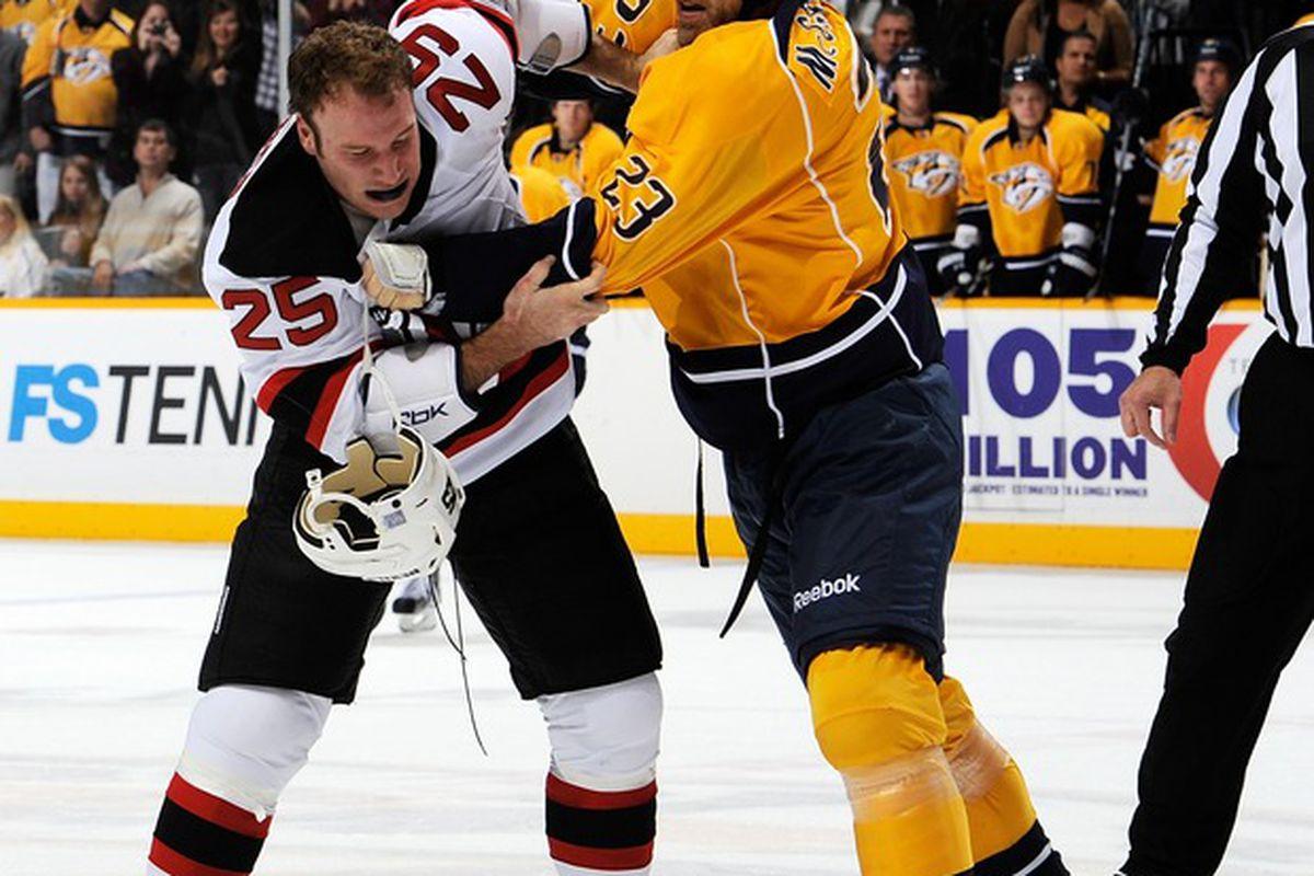 NASHVILLE, TN - OCTOBER 15:  Cam Janssen #25 of the New Jersey Devils fights Brian McGrattan #23 of the Nashville Predators at the Bridgestone Arena on October 15, 2011 in Nashville, Tennessee.  (Photo by Frederick Breedon/Getty Images)