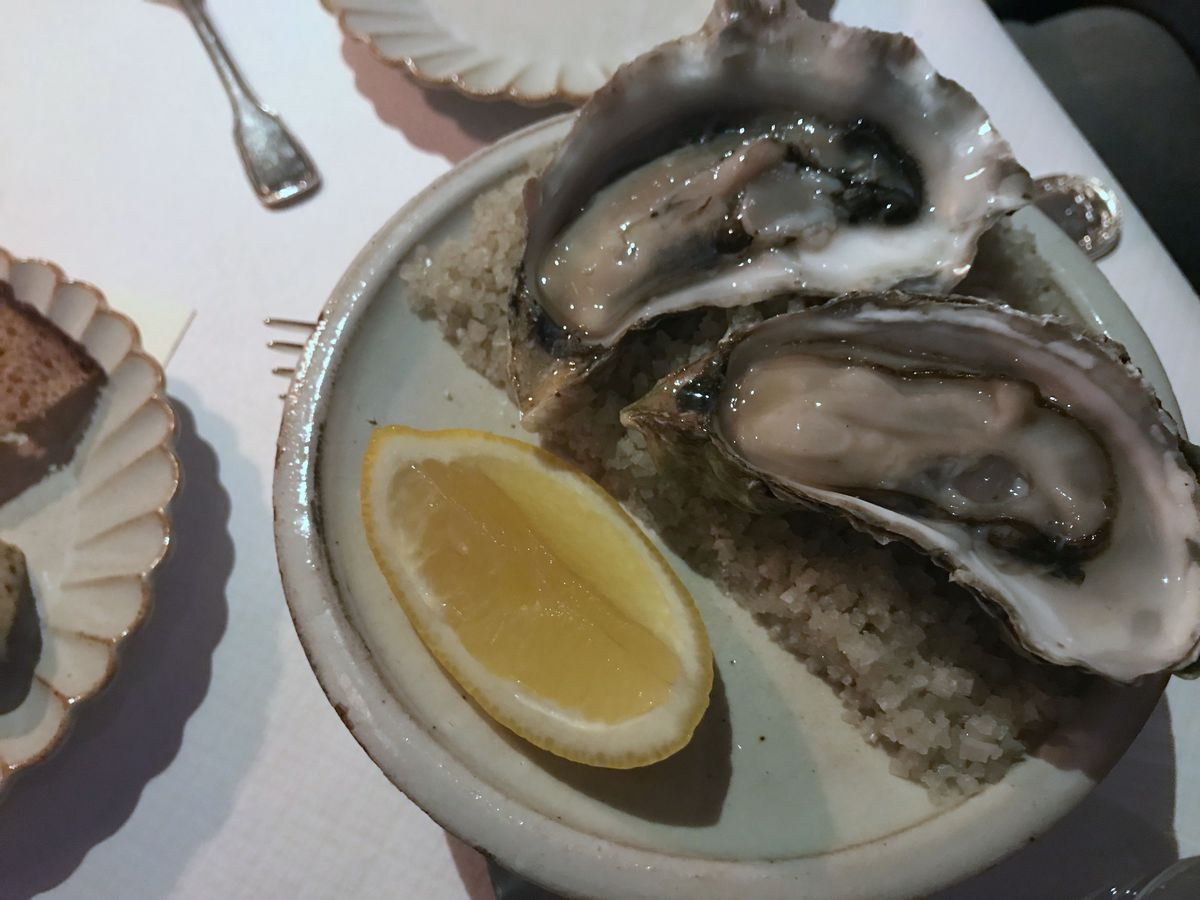 Oyster with seaweed butter and rye bread at La Mercerie