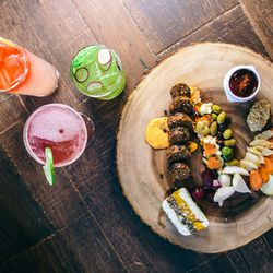 Served with a cocktail, the vegetarian charcuterie is an ideal entrée into Dodds' plant-focused menu.