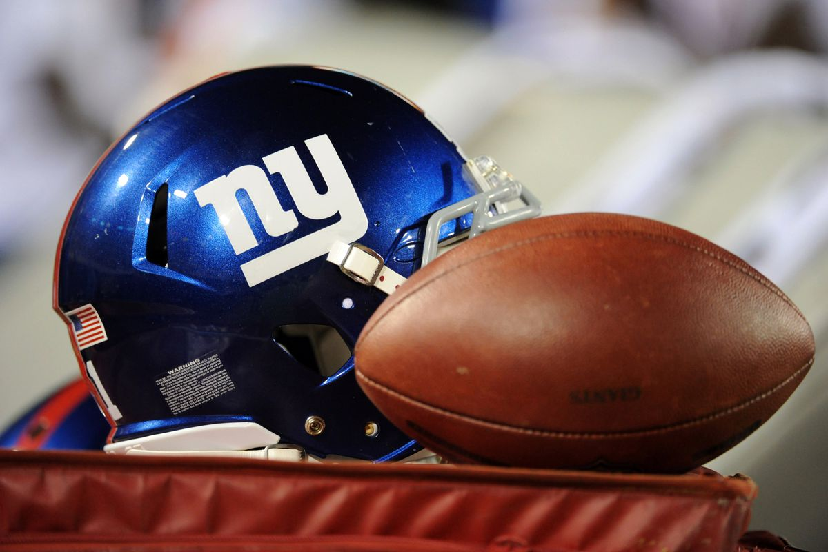 Aug 10, 2012;  Jacksonville, Florida, USA; A general view of a football and helmet during the Jacksonville Jaguars and New York Giants preseason game at EverBank Field. Melina Vastola-US PRESSWIRE