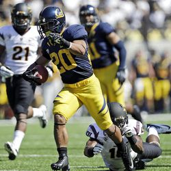 California running back Isi Sofele scores a touchdown past Arizona State safety Keelan Johnson during the first half of an NCAA college football game in Berkeley, Calif., Saturday, Sept. 29, 2012. (AP Photo/Marcio Jose Sanchez)