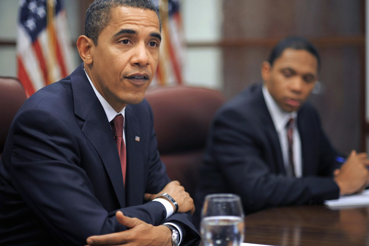President Barack Obama and White House aide Rob Nabors in a meeting.
