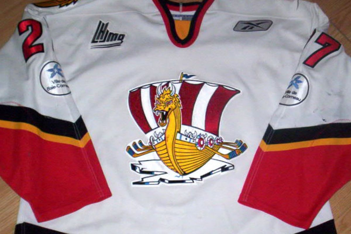 a QMJHL Baie Comeau Drakkars game worn jersey of defenseman Jean-Phillipe Paquet (drafted by the Pittsburgh in 2005) during the 2006-07 season. Note the hockey sticks used for oars on the Viking ship