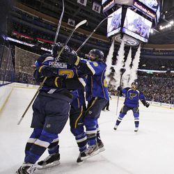 St. Louis Blues players celebrate after David Perron scored against the San Jose Sharks during the third period in Game 5 of an NHL Stanley Cup first-round hockey playoff series, Saturday, April 21, 2012, in St. Louis. The Blues won 3-1 and won the series 4-1.