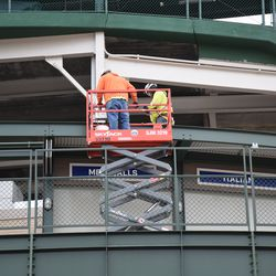 Workers in the bleachers
