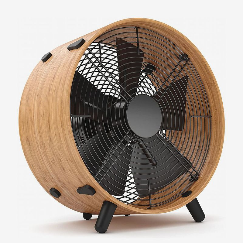 Round black fan with wooden frame.