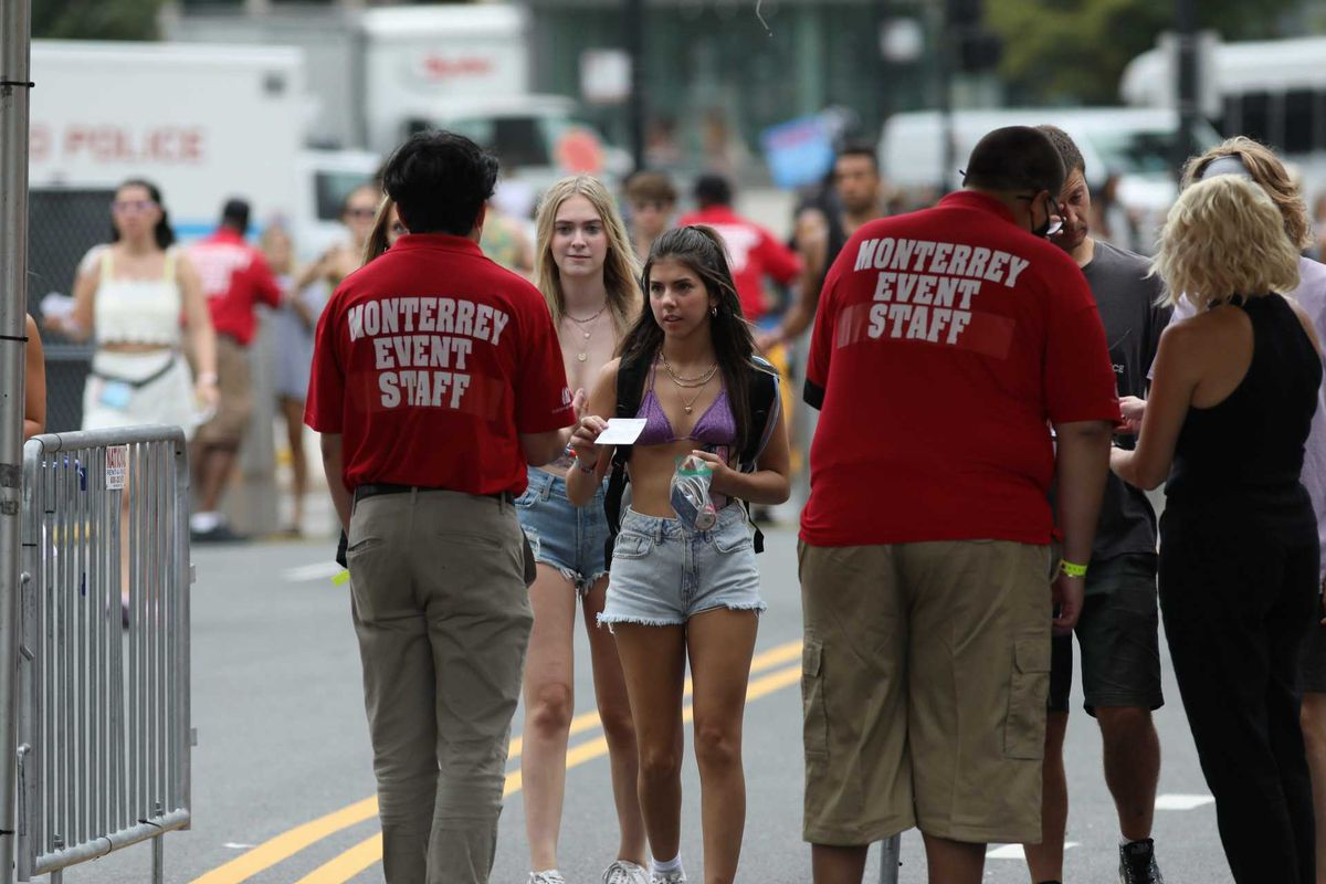 Attendees present their proof of vaccination cards at the entrance to Lollapalooza on Thursday.