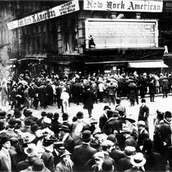"""ADVANCE FOR USE SUNDAY, APRIL 8, 2012 AND THEREAFTER - FILE - In this April 1912 file photo, crowds gather around the bulletin board of the New York American newspaper in New York, where the names of people rescued from the sinking Titanic are displayed. It was a news story that would change the news. From the moment that a brief Associated Press dispatch relayed the wireless distress call _ """"Titanic ... reported having struck an iceberg. The steamer said that immediate assistance was required"""" _ reporters and editors scrambled. In ways that seem familiar today, they adapted a dawning newsgathering technology and organized saturation coverage and managed to cover what one authority calls """"the first really, truly international news event where anyone anywhere in the world could pick up a newspaper and read about it."""" (AP Photo)"""