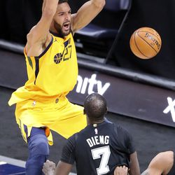 Utah Jazz center Rudy Gobert (27) dunks the ball in front of San Antonio Spurs center Gorgui Dieng (7) during an NBA game against the San Antonio Spurs at Vivint Smart Home Arena in Salt Lake City on Monday, May 3, 2021. The Jazz won 110-99.