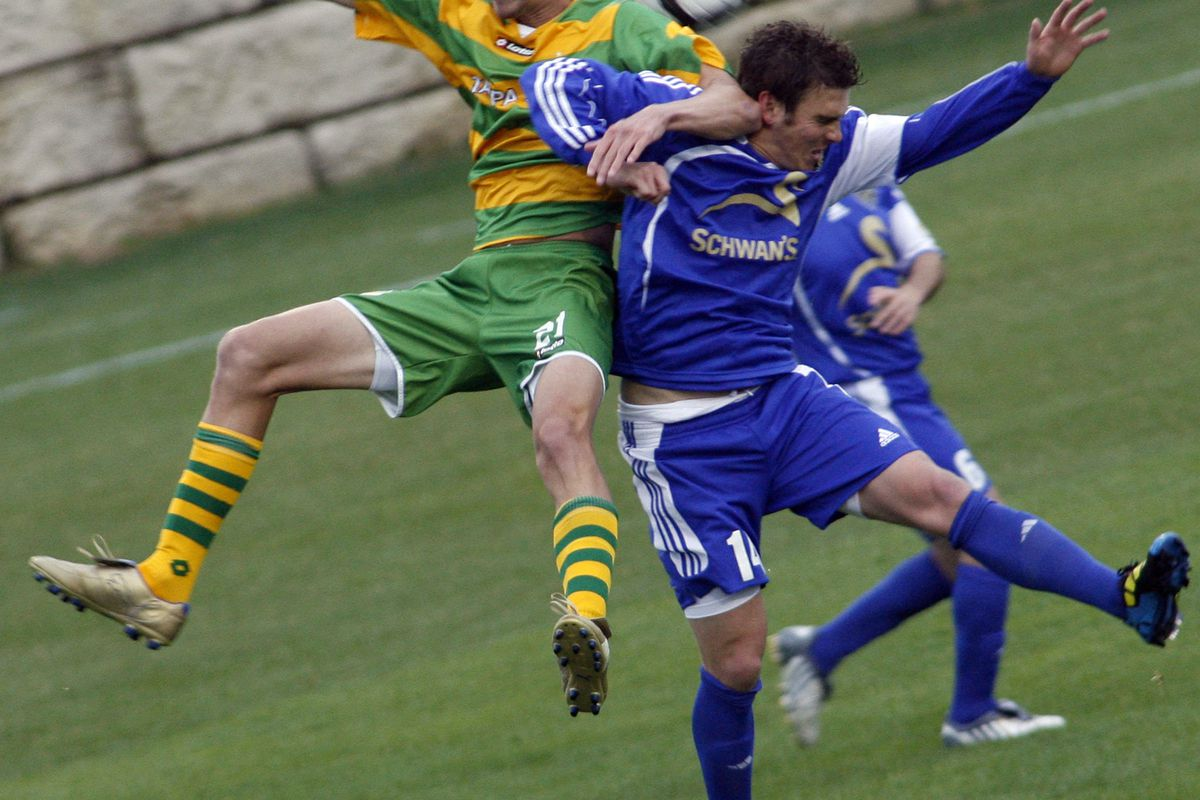 MARLIN LEVISON * mlevison@startribune.com April 24, 2010 - GENERAL INFORMATION: NSC Minnesota Stars vs. FC Tampa Bay soccer. IN THIS PHOTO: ] Tampa Bay's Aaron Wheeler, left and NSC's Brian Kallman collided at they attempted to control the soccer ball.