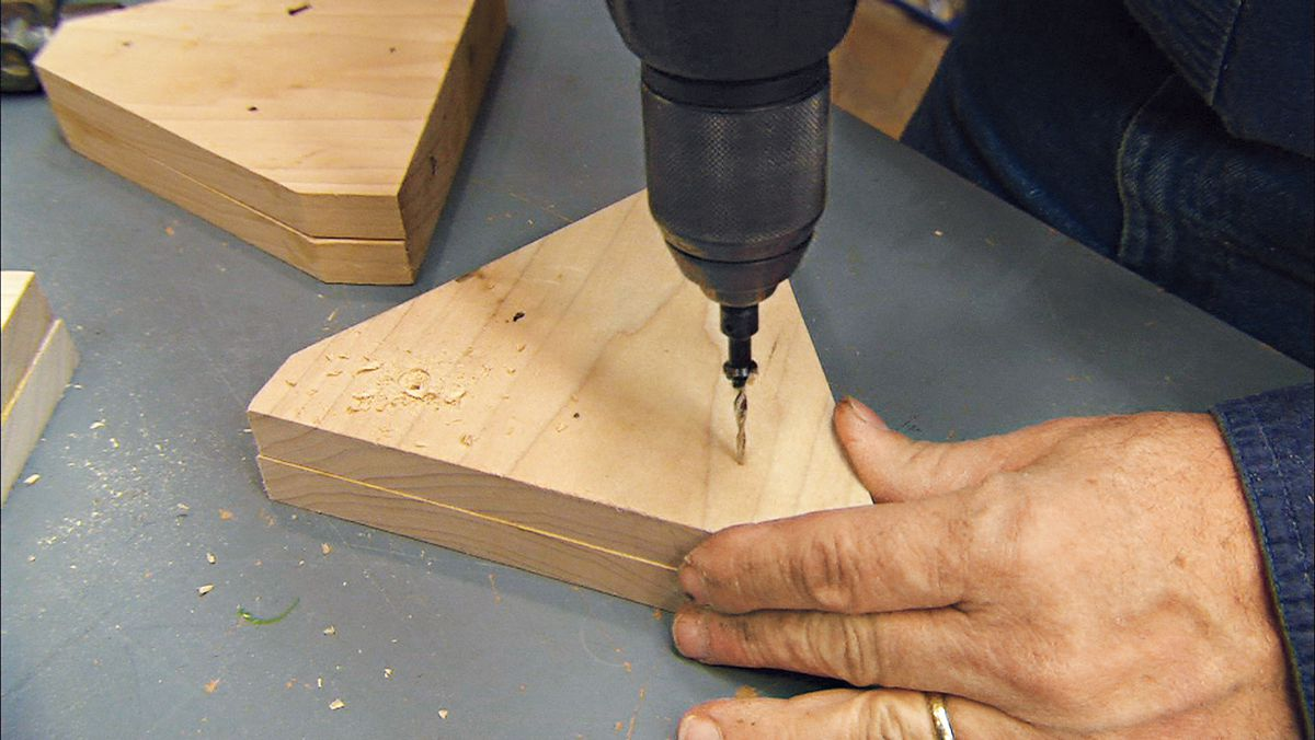 Screwing the supports together.