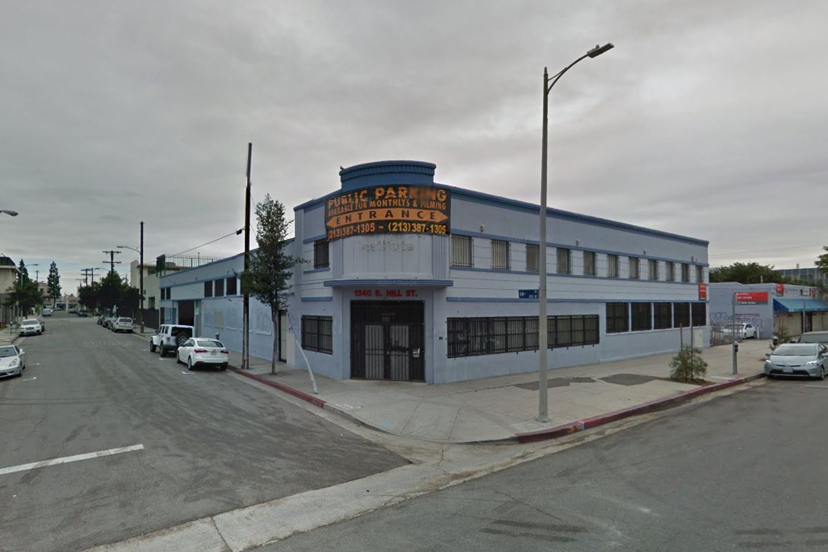 Two-story commercial building seen from across the street