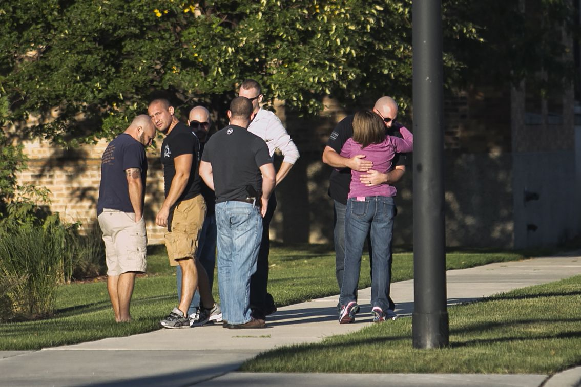 People hug and comfort one another outside the Cook County medical examiner's office after an off-duty Chicago Police officer was killed in a crash, Sunday, Sept. 18, 2016. | Ashlee Rezin/Sun-Times