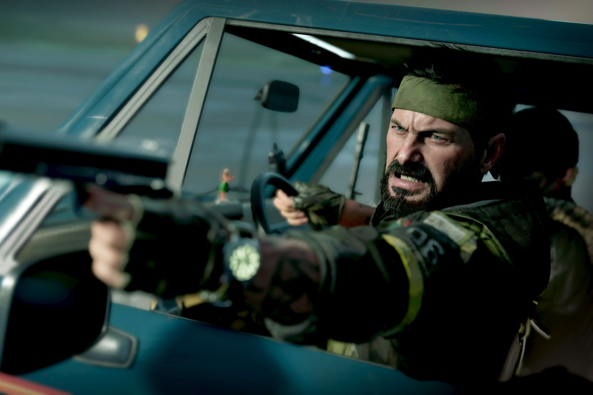 the hero of Call of Duty: Black Ops Cold War fires his pistol out the door of a car during a getaway scene
