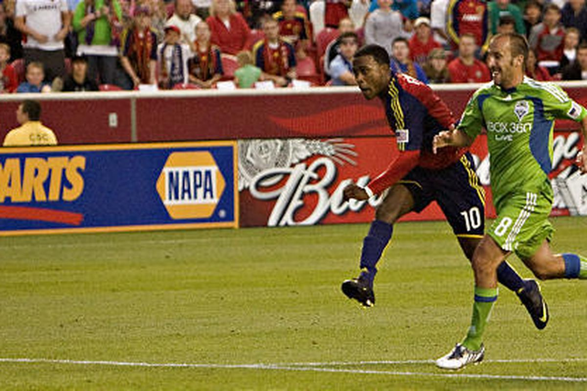 RSL's Robbie Findley strikes the game-winning goal from the 18 as he is guarded by Seattle's Peter Vagenas.