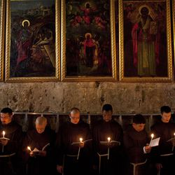 Catholic clergy attend a procession during Holy Saturday inside the Church of the Holy Sepulcher.