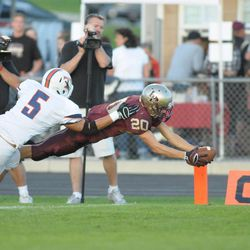 Lone Peak's Austin McChesney dives with the ball. Timpview reigned supreme over Lone Peak 36-33.