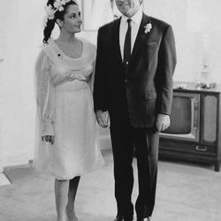 While Elizabeth Taylor gave us eight different bridal looks throughout her life, let's focus on dress #5: a yellow chiffon number by Cleopatra costume designer Irene Sharaff for the actress's first wedding (on March 15th, 1964) to Richard Burton.