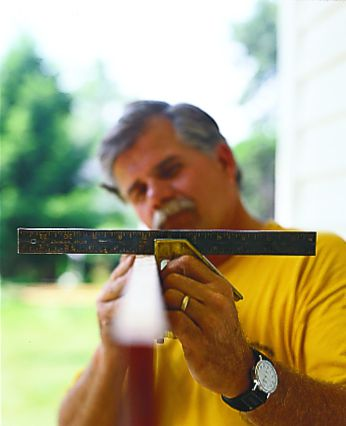 Person planing a long edge by applying pressure with both hands and pushing down the front knob forward with the rear handle.
