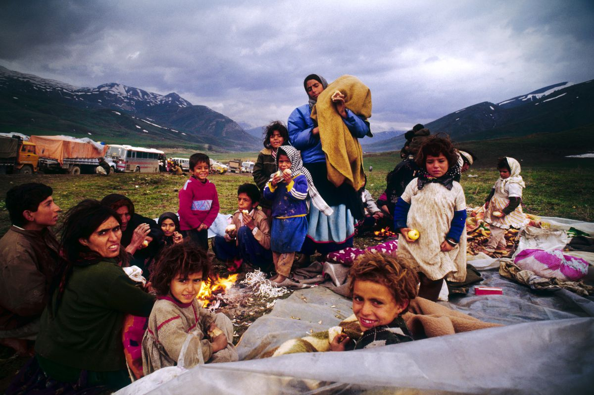 Kurdish refugees set up camp during their move to Iran.