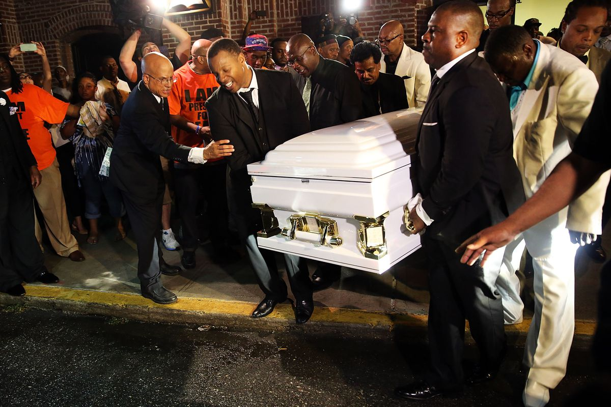 The casket carrying Eric Garner is brought out after his funeral outside the Bethel Baptist Church on July 23, 2014 in New York City