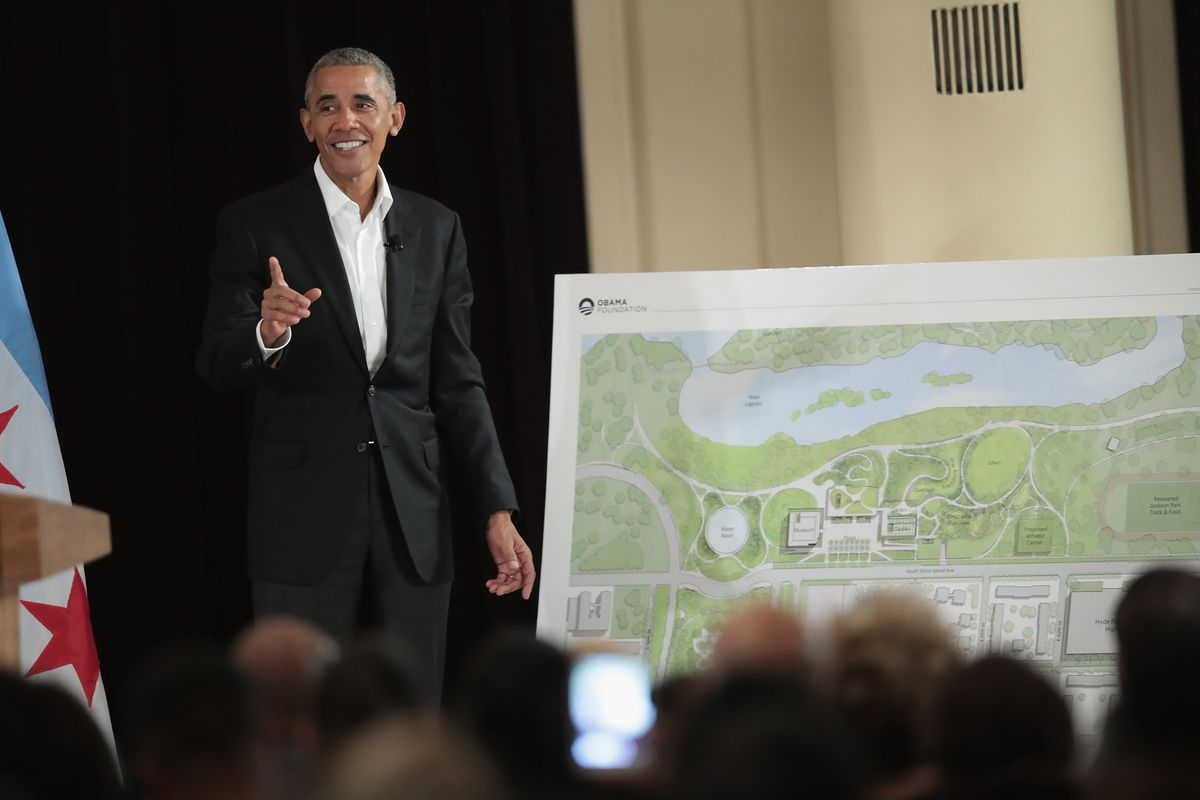 Former President Barack Obama pointing out features of the proposed Obama Presidential Center during a 2017 community.