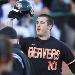 Oregon State Beavers player Dylan Davis (10) is congratulated by teammates after hitting a home run against the Kansas State Wildcats in the first inning of   the Corvallis Super Regional.