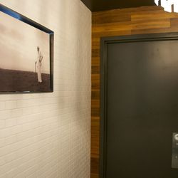 Remember that photo of Col. Sanders mentioned earlier? It's outside the restroom, where the Colonel apparently will wait throughout eternity for a pee that'll never arrive.