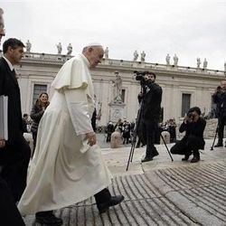 Pope Francis arrives in St. Peter's Square to attend the weekly general audience at the Vatican, Wednesday, Nov. 12, 2014.