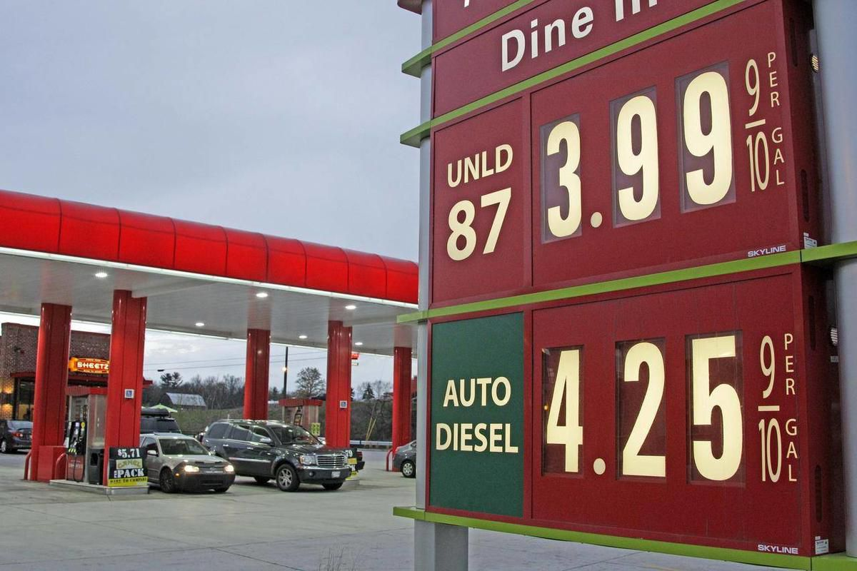 FILE - In this April 9, 2012 file photo, gas prices are posted at a gas station in Breezewood, Pa.  Pump prices rose relentlessly from January through April, pushing average gas prices above $3.90 a gallon and taxing families' budgets. Some forecasters ex