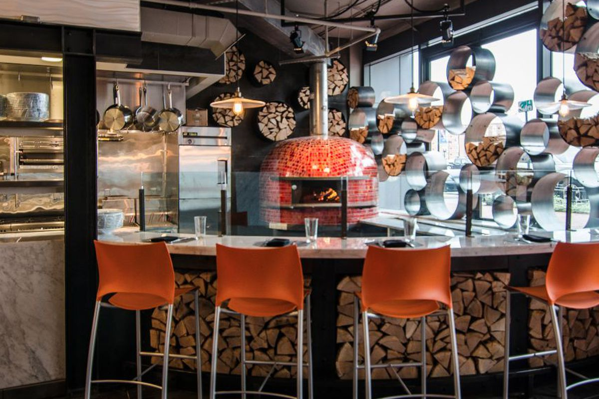 """<a href=""""http://dc.eater.com/archives/2013/12/18/orange-accents-huge-oven-at-alba-osteria.php"""">Alba Osteria, Washington, DC</a>."""