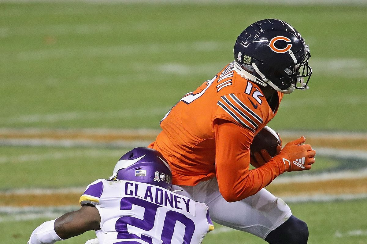 Jeff Gladney #20 of the Minnesota Vikings hits Allen Robinson #12 of the Chicago Bears at Soldier Field on November 16, 2020 in Chicago, Illinois.