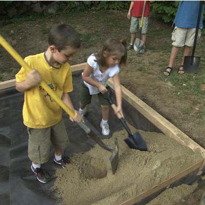 Kids Fill Sandbox With Sand