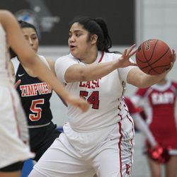 East's Lani Taliauli looks to pass the ball during East's 68-48 victory against Timpview in the Class 5A state championship game at Salt Lake Community College in Taylorsville on Saturday, Feb. 24, 2018.