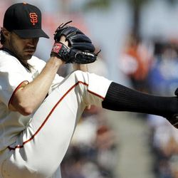 San Francisco Giants starting pitcher Barry Zito throws to the Arizona Diamondbacks during the first inning of a baseball game, Thursday, Sept. 27, 2012, in San Francisco.