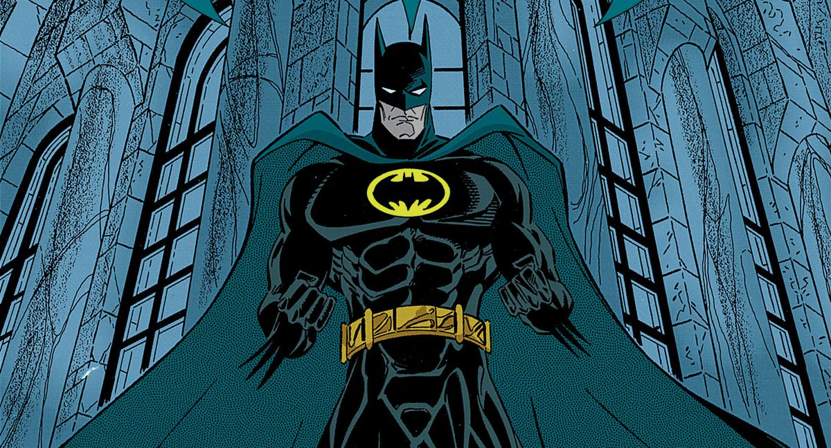 Batman stands high on a gothic building, fists ready. His costume is all black with a dark blue-grey cape, and a black bat symbol on a yellow oval, on the cover of Detective Comics #682, DC Comics (1995).