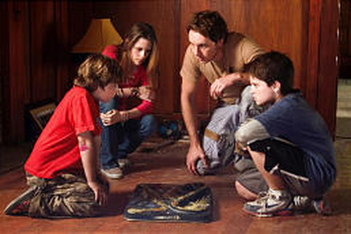 """Actors Jonah Bobo, left, Kristen Stewart, Dax Shepard and Josh Hutcherson star in Columbia Pictures' heart-racing science-fiction family film """"Zathura: A Space Adventure."""" Utah County movie listings are always online."""