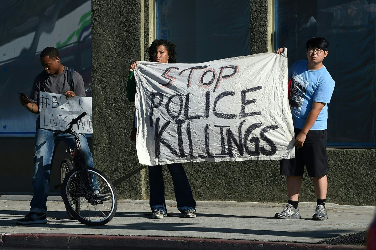 Protesters demonstrate against the fatal police killings of Philando Castile and Alton Sterling, in July 2016.