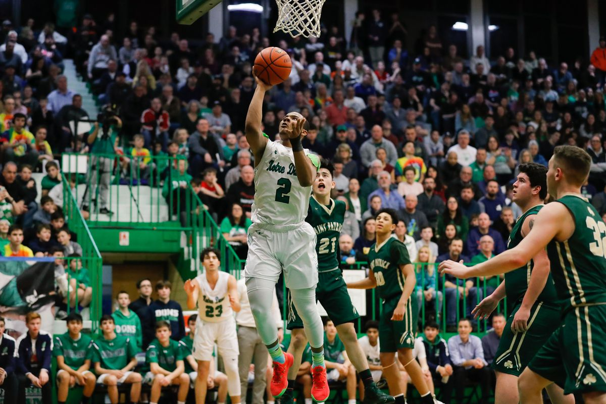Notre Dame's Anthony Sayles (2) takes the ball to the basket against St. Patrick.