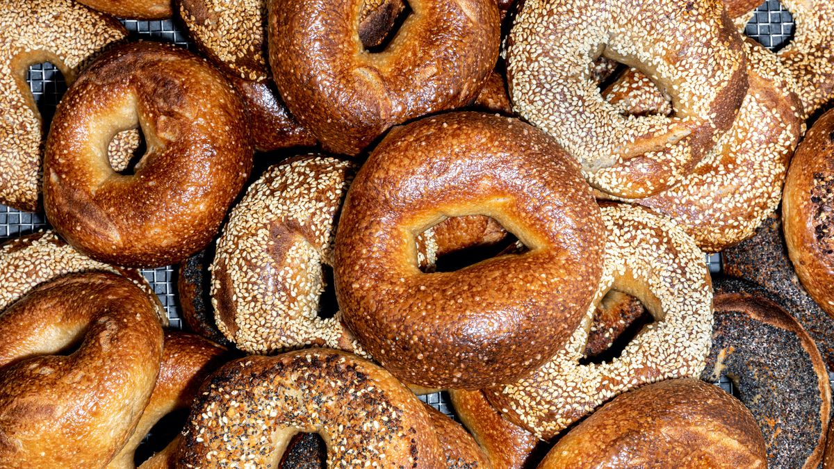 A mountain of golden bagels from Bagel and Slice in Highland Park.
