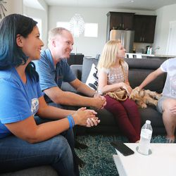 Utah Falconz owner and player Hiroko Jolley and her husband Troy talk with their son Derek and daughter Rachel in Midvale on Friday, July 10, 2015.