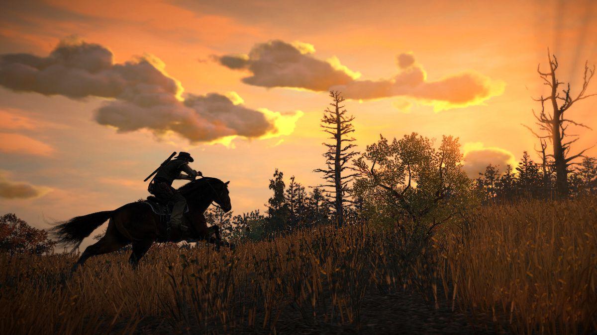 Red Dead Redemption - John Marston on horseback riding through grass at sunset