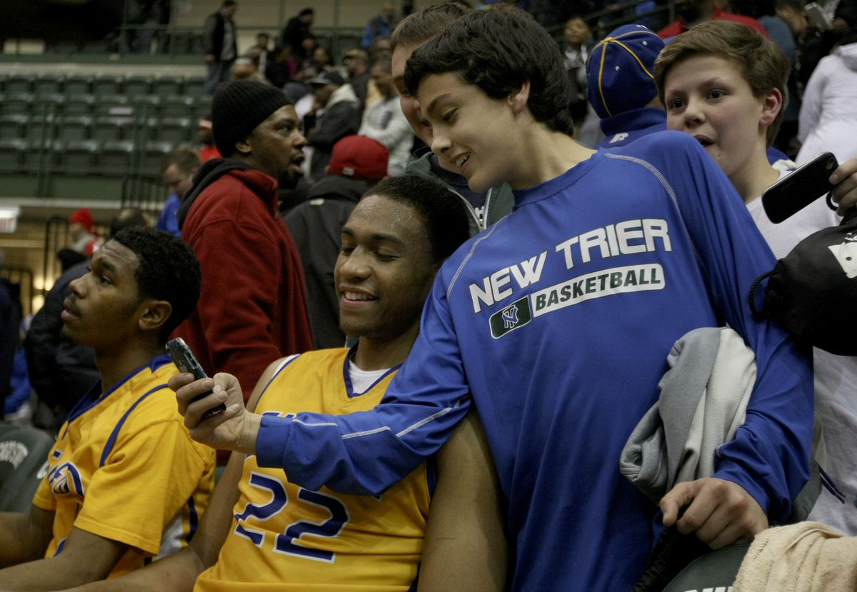 Some New Trier fans get their photo taken with Simeon's Jabari Parker after their team's loss in the IHSA Class 4A super sectional at Chicago State University in 2013.