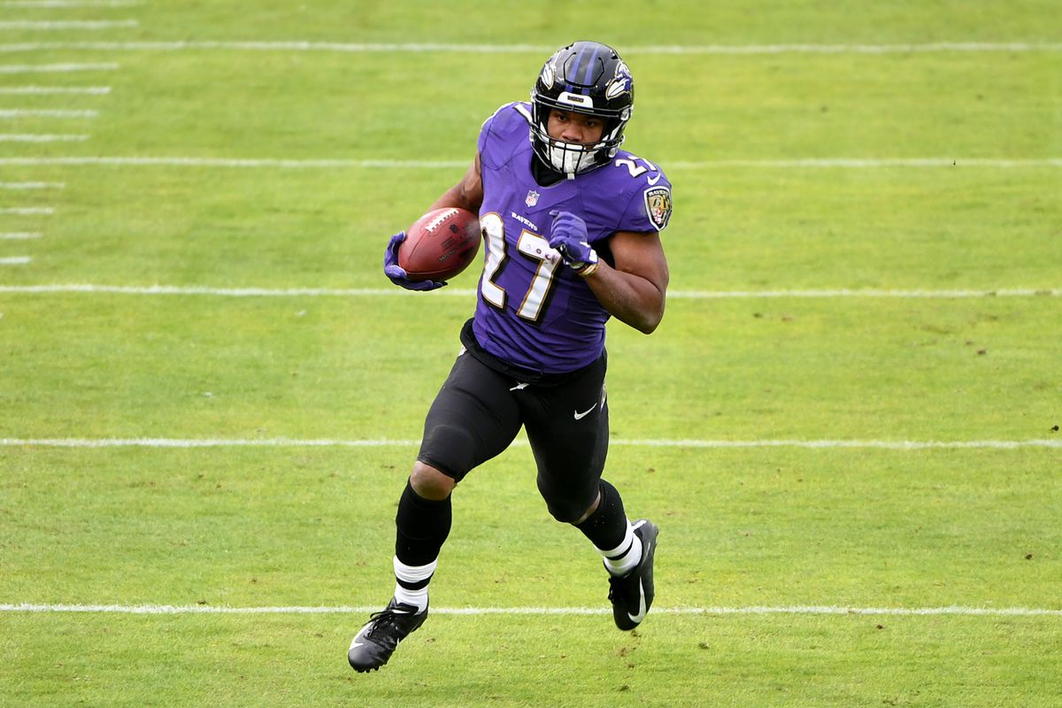Running back J.K. Dobbins #27 of the Baltimore Ravens runs against the Jacksonville Jaguars during the first half at M&T Bank Stadium on December 20, 2020 in Baltimore, Maryland.