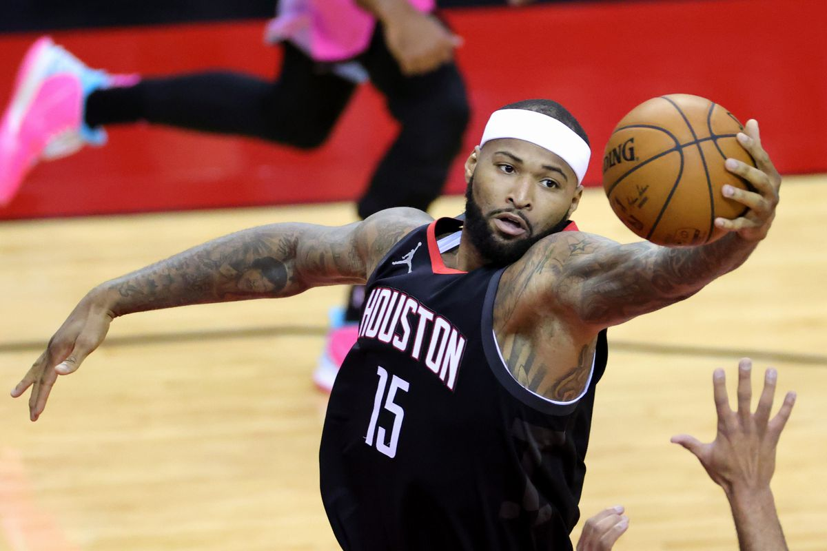 Houston Rockets center DeMarcus Cousins (15) reaches for a rebound during the second quarter against the Miami Heat at Toyota Center.